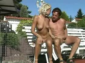 Naughty couple outdoor sex on bench