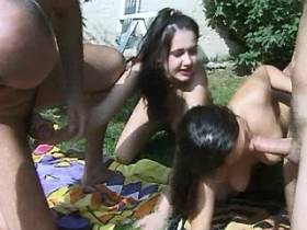 Sexy bronzed people in outdoor orgy