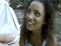 Ebony sweety sucking so yummy white penis outdoors