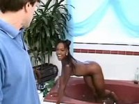 Lustful ebony chick sucking white penis in bath