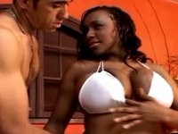 Steamy ebony with huge boobs sucks and titfucks