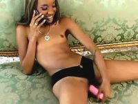 Slim ebony with tiny perky tits goes horny on sofa